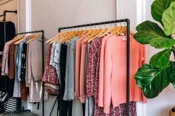 Pink clothes on racks.