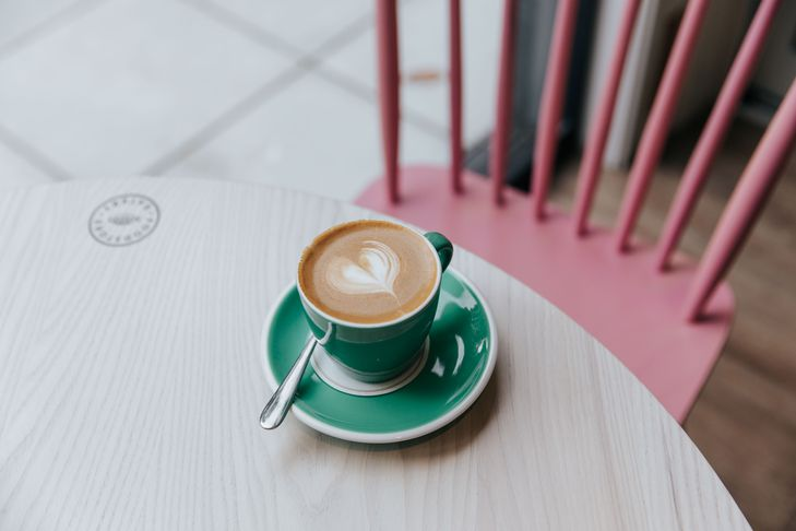 Close up of a flat white on a table.