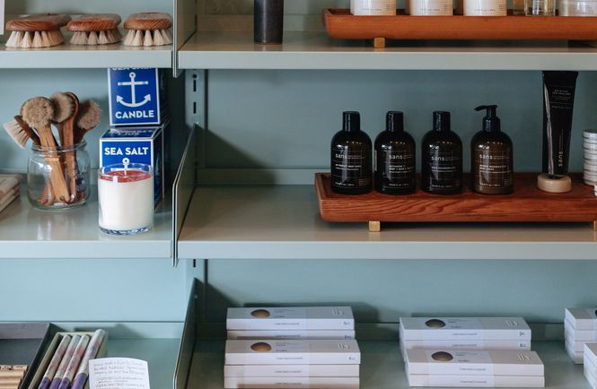 Homewares neatly displayed on shelves inside Everyday Needs in Auckland.