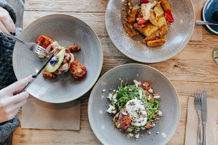 A flatlay of brunch meals on a table at The Batch in Invercargill.