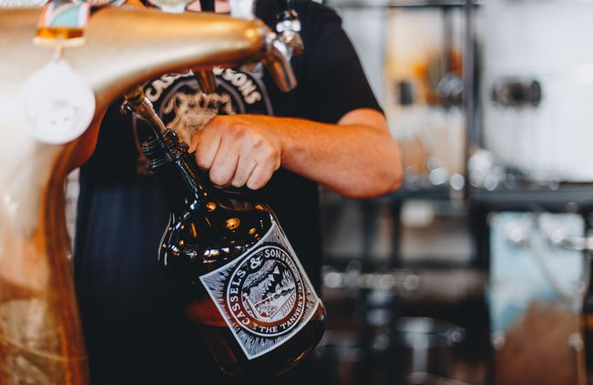 A bottle being filled up with craft beer at The Brewery Christchurch.