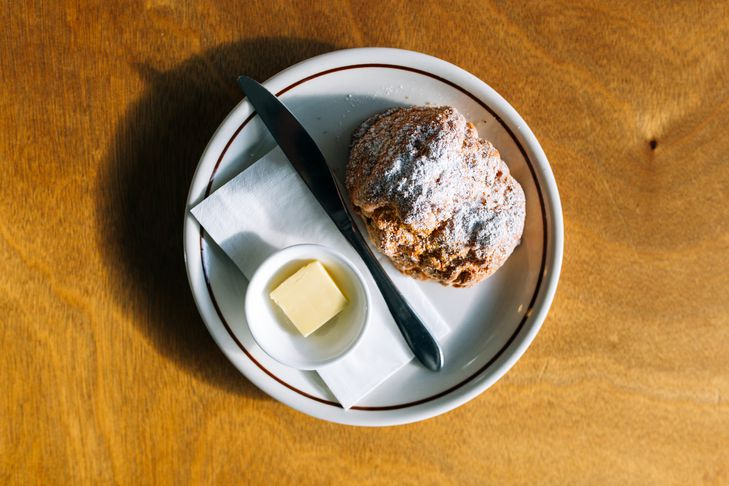 A scone on a table at Miltons Canteen cafe Hamilton.