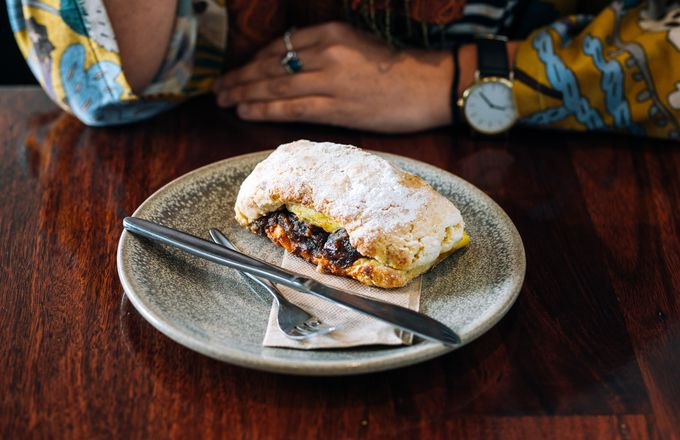 A scone at a table at River Kitchen cafe Hamilton.