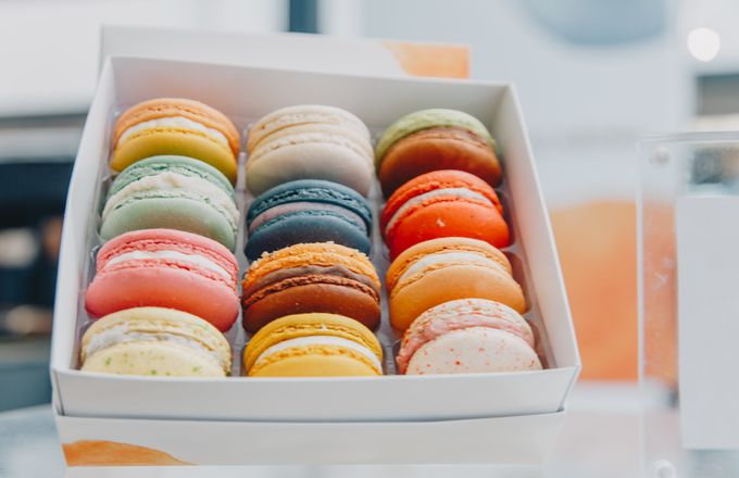 A box of colourful macarons.