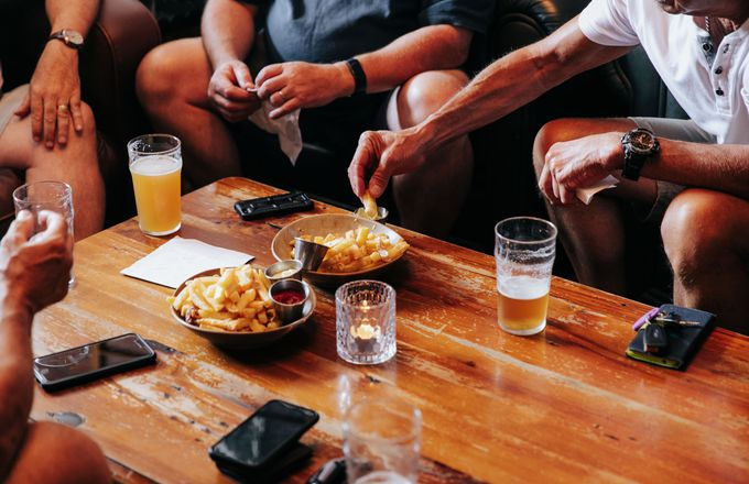 Hot chips and beers on a table.