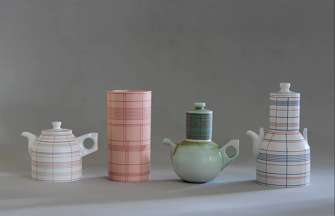 Ceramic jugs on a table.