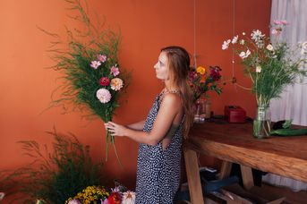 Woman arranging flowers.