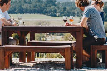 Three people drinking wine at Terrace Edge winery in Waipara, North Canterbury.