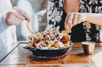 A bowl of loaded fries at Lower 9th Diner restaurant in Christchurch.