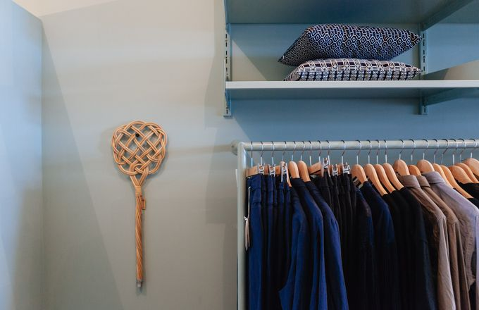 Clothes and homewares displayed on shelves.