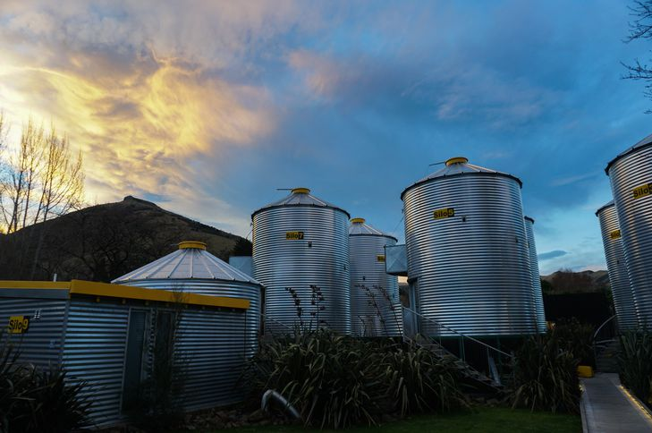 Silos against the evening sky.