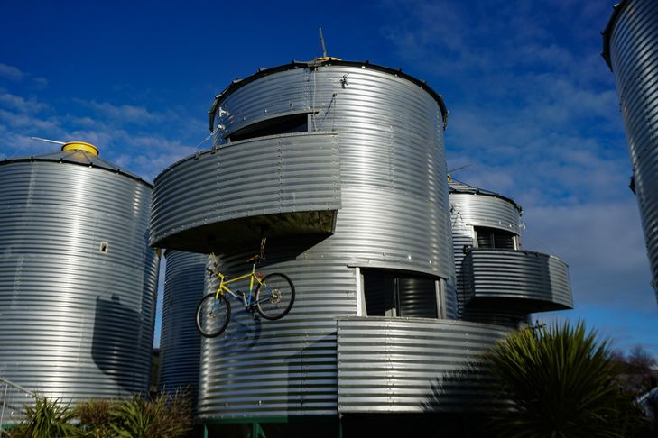 Silo with bike suspended below.