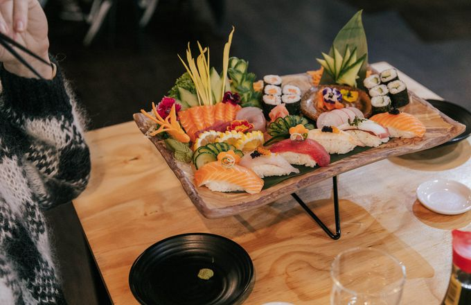 A plate of sushi on a table.