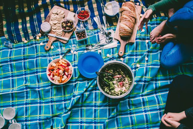 A picnic on blankets.