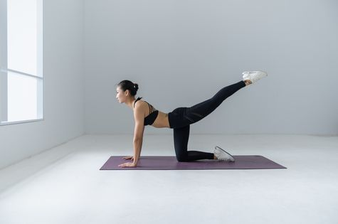 A woman doing yoga in a studio.