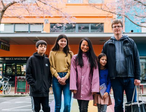 Mahalee and Benoit with their family on the streets of Palmerston North.