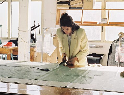 Rachel Mills at work cutting a pattern.