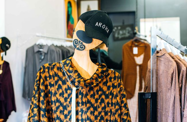 A dressed mannequin with 'Aroha' cap.