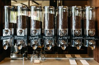 Coffee beans in glass dispensers.