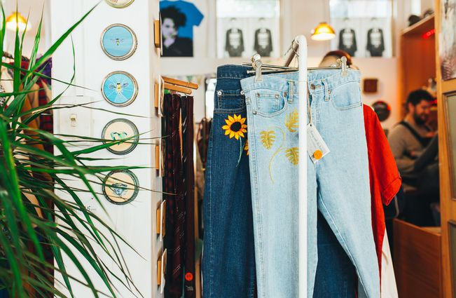 Second hand jeans with sunflower embroidery.