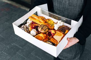 Close up of pastries in a box.