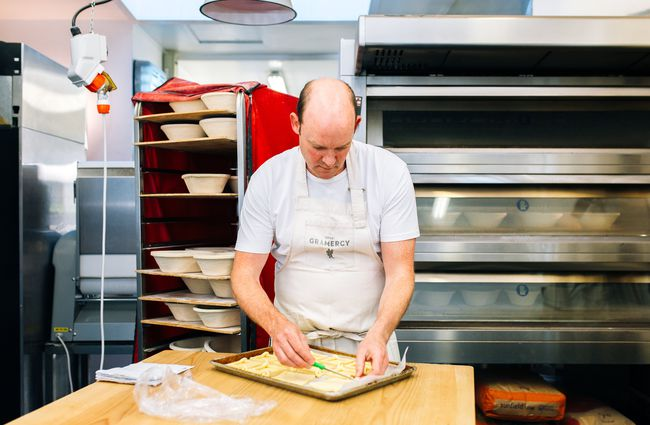 A man baking in the kitchen.