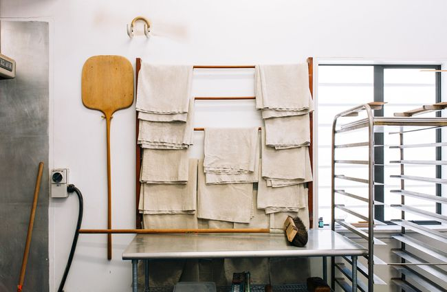 Towels hanging in the kitchen.
