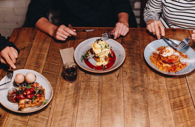 Three customers with meals at Black Betty, Christchurch.