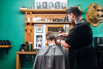 Barber giving man a hair cut.