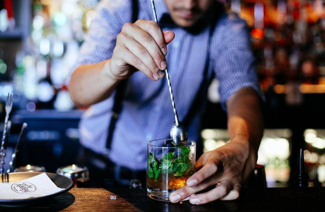 A cocktail being made by a bar man.