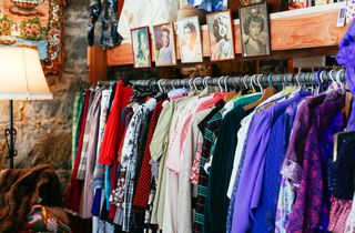 Colourful rack of vintage clothing.