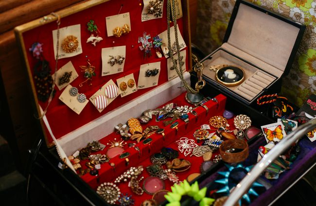 Vintage jewellery in a red box.