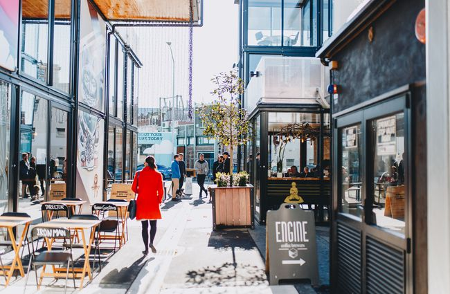 A woman walking down a laneway at The Boxed Quarter Christchurch.