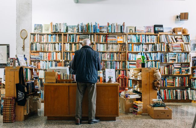 Man buys books from counter at Browsers Quality Secondhand Bookshop, Hamilton.