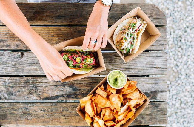 Flatlay of chips and tacos.