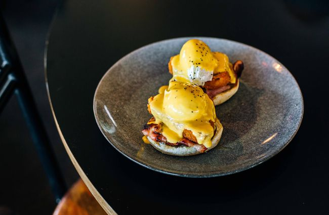 Eggs benedict on a table.