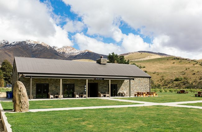 Cardrona Distillery in front of the mountains.