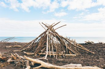 Structure made from sticks on the beach.