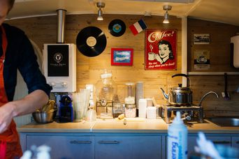 Behind the counter inside the caravan.