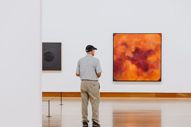 A man browsing the art.