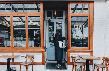 A woman walking into Civil and Naval bar, Lyttelton.