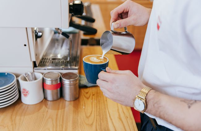 Barista pours a coffee.