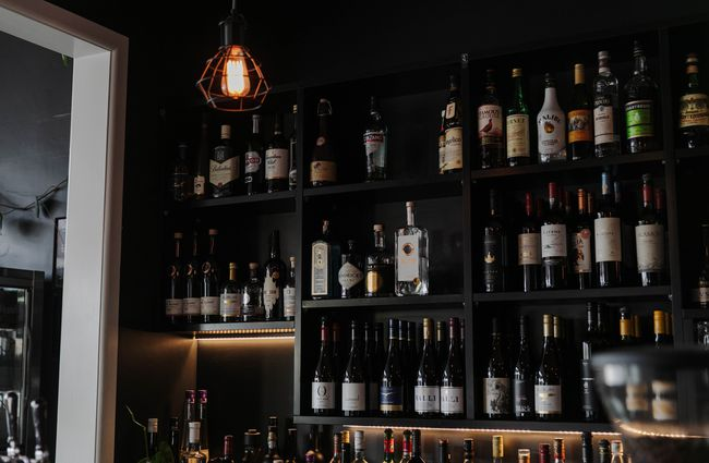 Close up of shelves of bottles at the bar in Cucina.