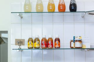 Coloured drinks on shelves.