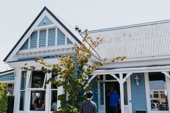 Blue cottage exterior with white trim.