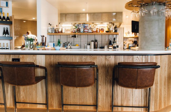Bar with brown leather stools.