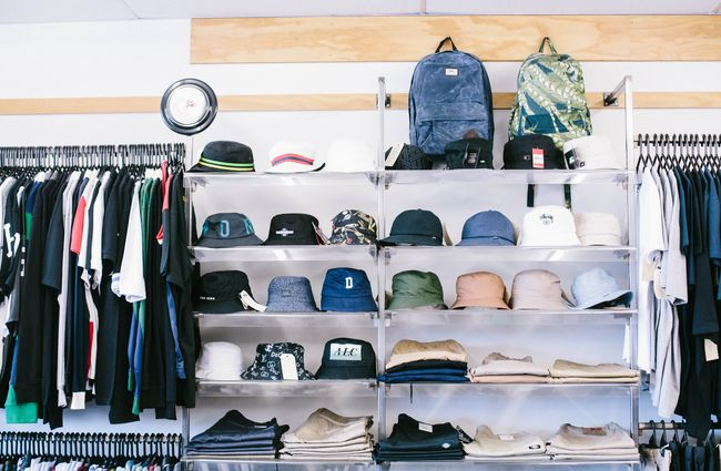 Hats lined up on a shelf.