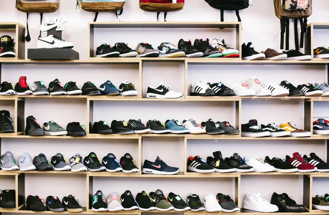 Shoes lined up on a shelf.