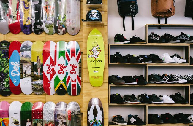 Skateboards and shoes on display.