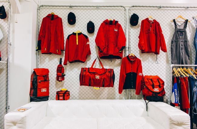 Red clothing hanging from wall.